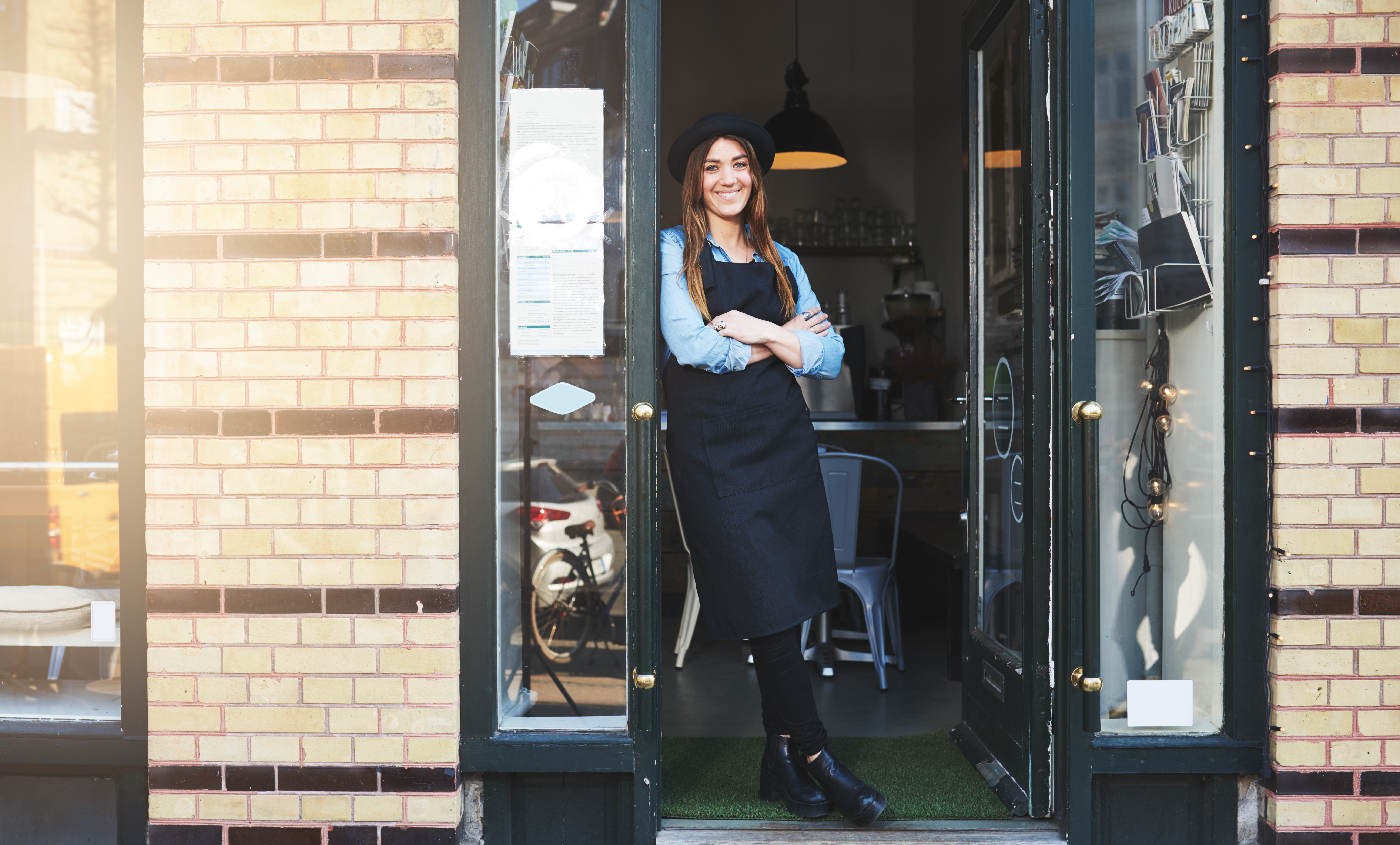 Young business woman leaning against doorway