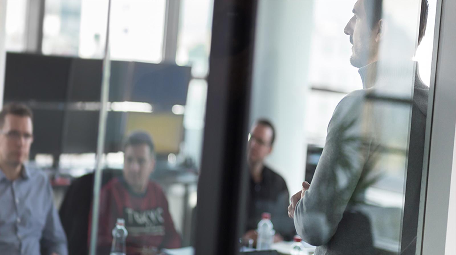 Business team leader delivering presentation in office.